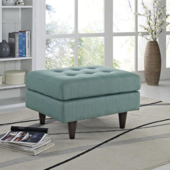 Upholstered fabric ottoman in laguna