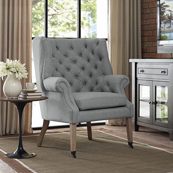 Upholstered fabric lounge chair in light gray