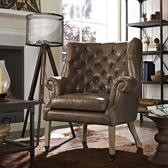 Upholstered vinyl lounge chair in brown