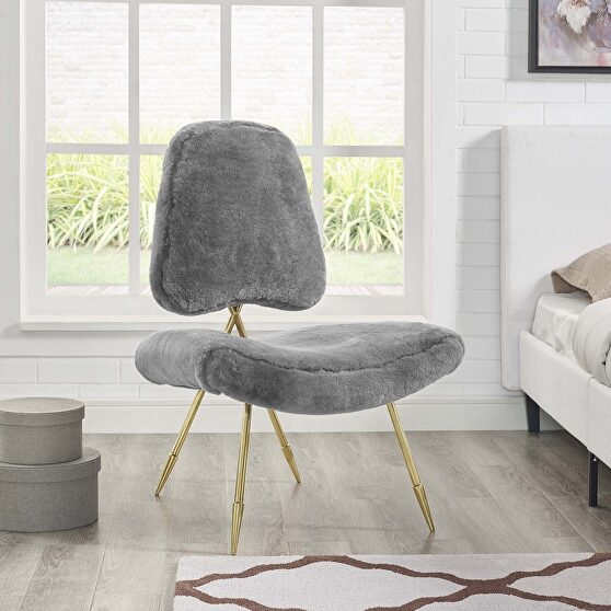 Upholstered sheepskin fur lounge chair in gray