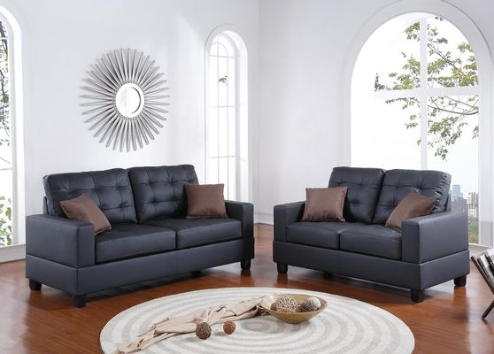 Black faux leather sofa and loveseat set