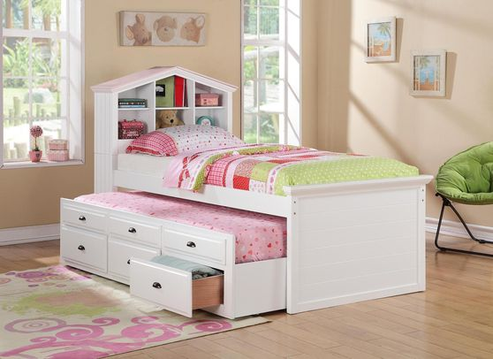 White twin bed with trundle and storage shelves